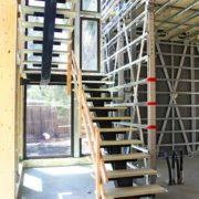 Palo Alto Online | The stairwell inside the BONE Structures home currently being constructed on June 20. Photo by Veronica Weber.
